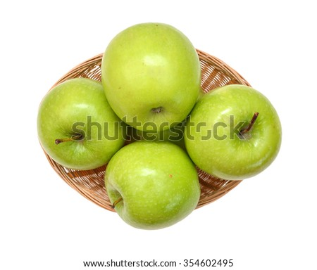 Green apples isolated in basket on white background - stock photo