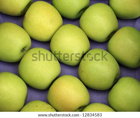 Green apples on a blue background