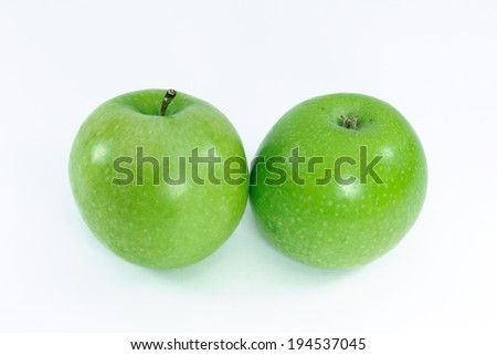 Green apples on a white background