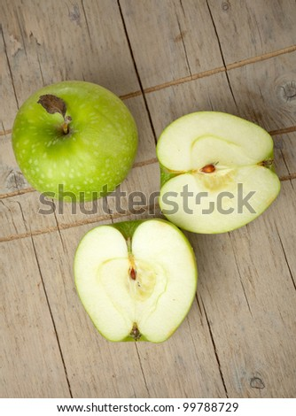 Green apples on wooden table - stock photo