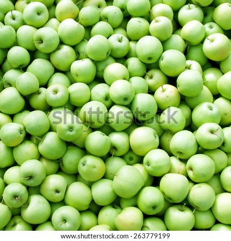 Green apples pile background. - stock photo