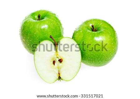 Green apples whole and half isolated on white background - stock photo