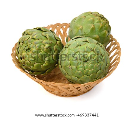 Green artichoke in basket on white background