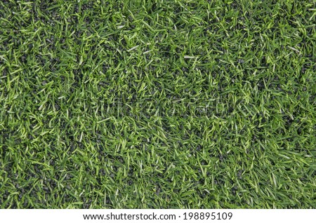 Green artifical turf, Synthetic green grass football pitch  - stock photo