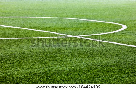 Green artificial grass soccer field for background - stock photo