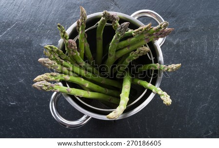 Green asparagus in the pot - stock photo