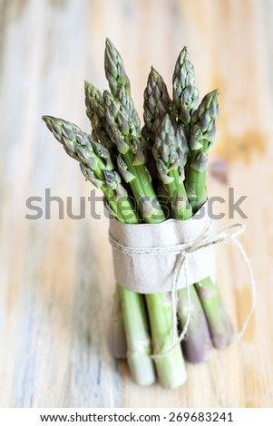 Green asparagus on wooden background - stock photo