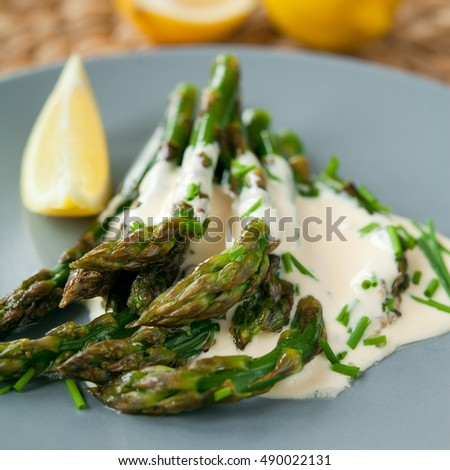 green asparagus with garlic, lemon and chives.