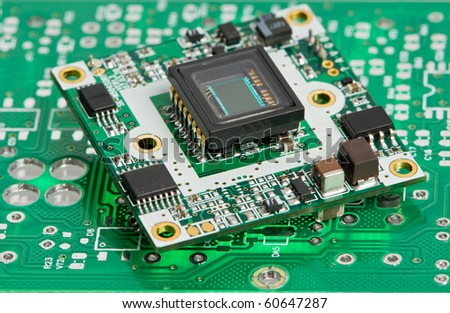 Green assembled integrated microcircuit board with semiconductor elements - stock photo