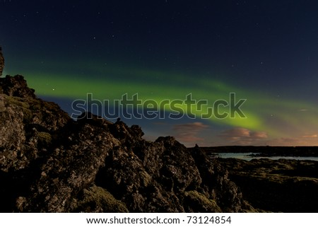 Green aurora or northern lights at the Blue Lagoon spa in Iceland - stock photo