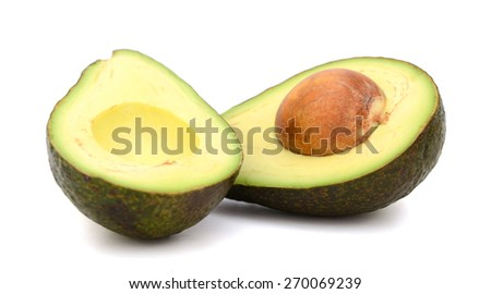 green avocado cut in half isolated on white  - stock photo