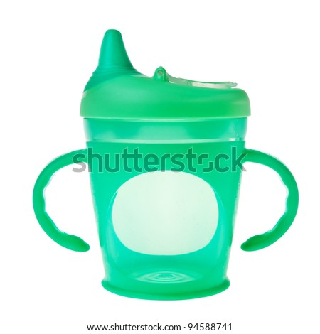 Green baby plastic cup with handles isolated over white background. - stock photo