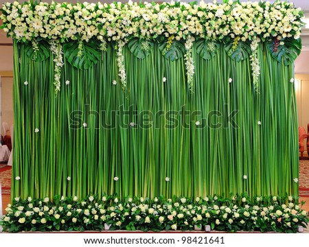 Green backdrop flowers arrangement for wedding ceremony - stock photo
