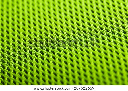 green background. Mesh fabric texture. Macro perspective - stock photo