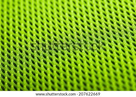green background. Mesh fabric texture. Macro perspective - stock photo