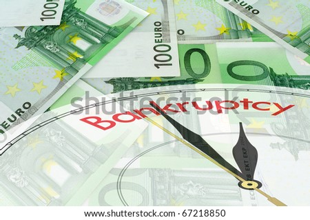 Green background of euro bills with clock face - bankruptcy concept - stock photo