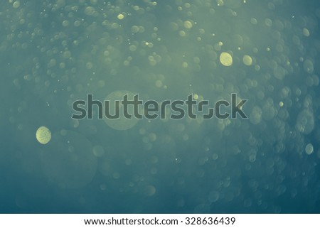green background with defocused lights - stock photo