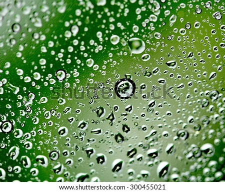Green background with drops of water, macro close-up - stock photo