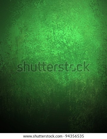 green background with vintage grunge texture and deep black vignette shading on border of frame with highlight spot for copy space text or image or St. Patrick's Day or Christmas holidays - stock photo