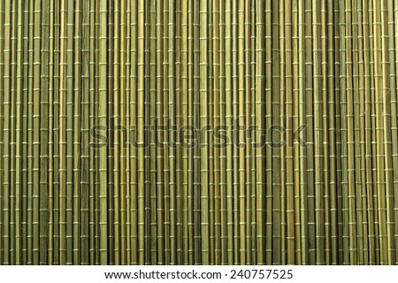 Green bamboo mat for sushi cooking and kitchen table decorating - stock photo