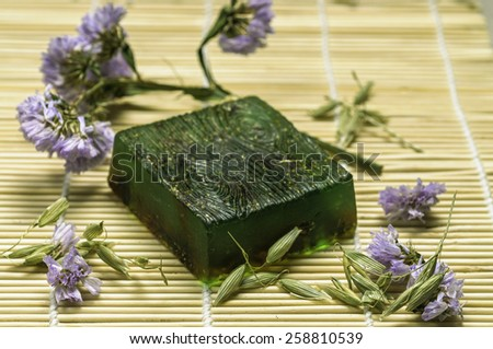 green bar soap with flowers - stock photo