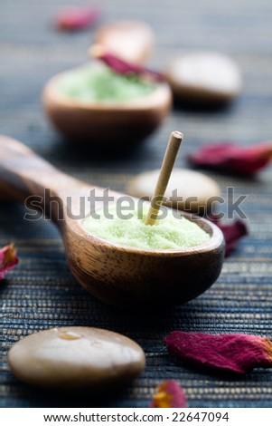 Green bath salt on wooden spoon - stock photo