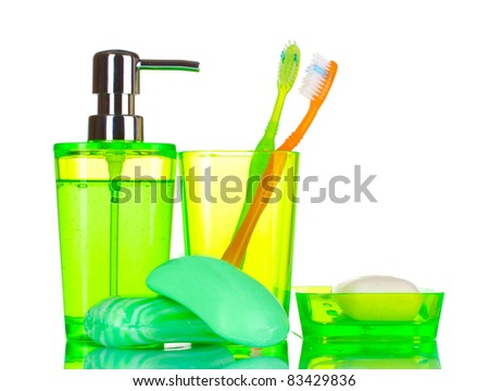 green bathroom accessories and soap isolated on white