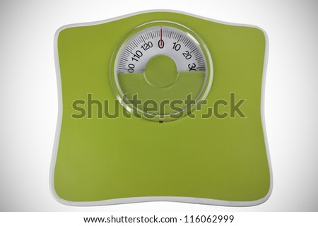 Green bathroom scale isolated in white