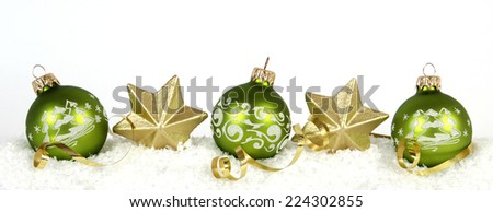 Green baubles and golden stars - stock photo