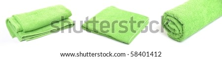 green beach or bath towel collection isolated on white background - stock photo