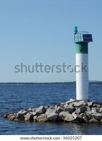 Green beacon on Ottawa River - stock photo