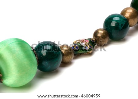 green beads isolated on white background