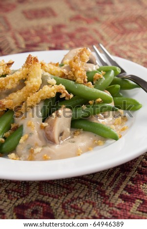 Green bean casserole - a traditional Thanksgiving side dish. Green beans with cream of mushroom soup and topped with french-fried onions.