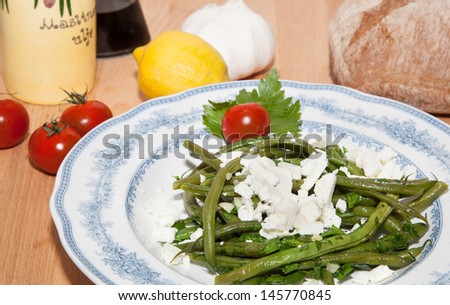 Green beans; garlic; white cheese and bread. - stock photo
