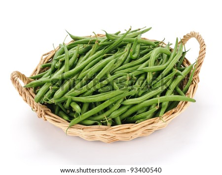 Green beans in the basket on white background - stock photo