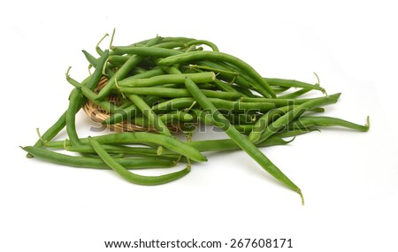 Green beans isolated and basket on a white background.