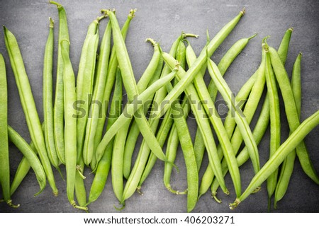 Green beans  on a gray background.