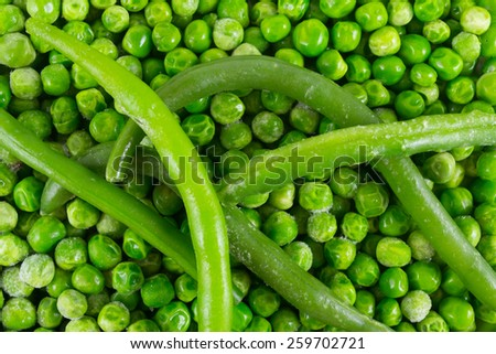 Green beans on the peas background - stock photo