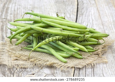green beans on wooden background - stock photo