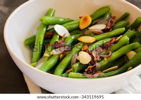 Green beans with almonds close up, selective focus / Thanksgiving side dish
