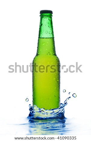 Green beer bottle with water drops and splash isolated on white - stock photo