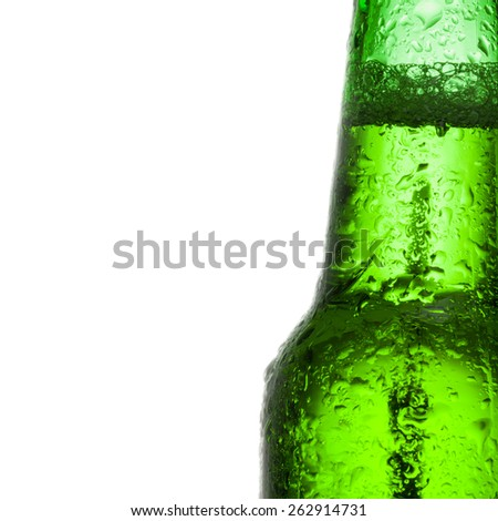 Green beer bottle with water drops over white background - stock photo