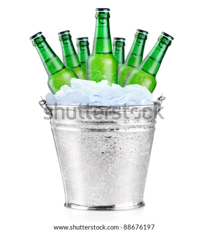 Green beer bottles in ice - stock photo