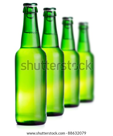 Green beer bottles on the white background - stock photo