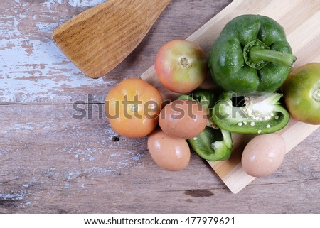 green bell pepper, tomato and eag with wood background. Selective focus,shallow depth of field.Vibrant Colors