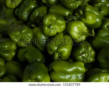 Green bell peppers at the local farmer's market. - stock photo