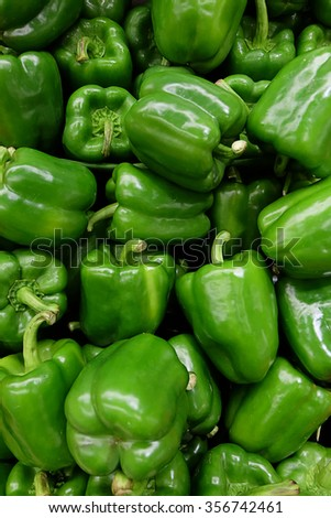 Green bell peppers, natural background - stock photo