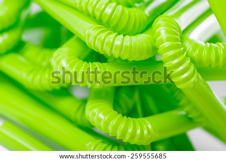Green bendy straws. - stock photo