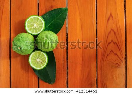 Green bergamot with leaves on wood background - stock photo