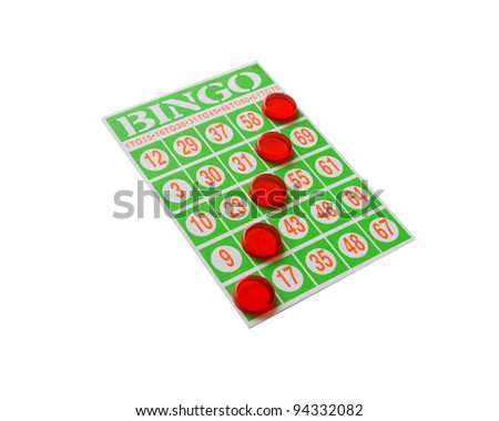 Green bingo card with winning chips. - stock photo